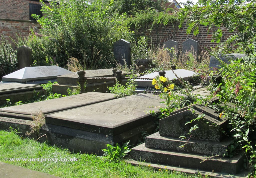 Remains of the old St Mary's burial ground, with many ancient grave markers.